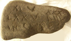 Obverse side of stone with a Latin inscription found in rural New York.
